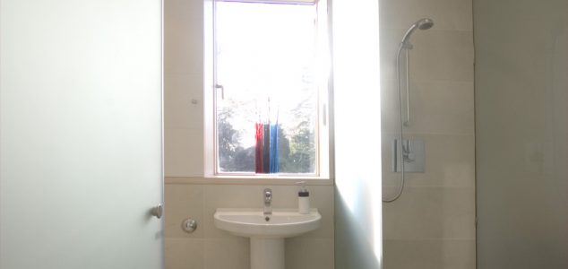 bathroom in glass with a teak shower tray