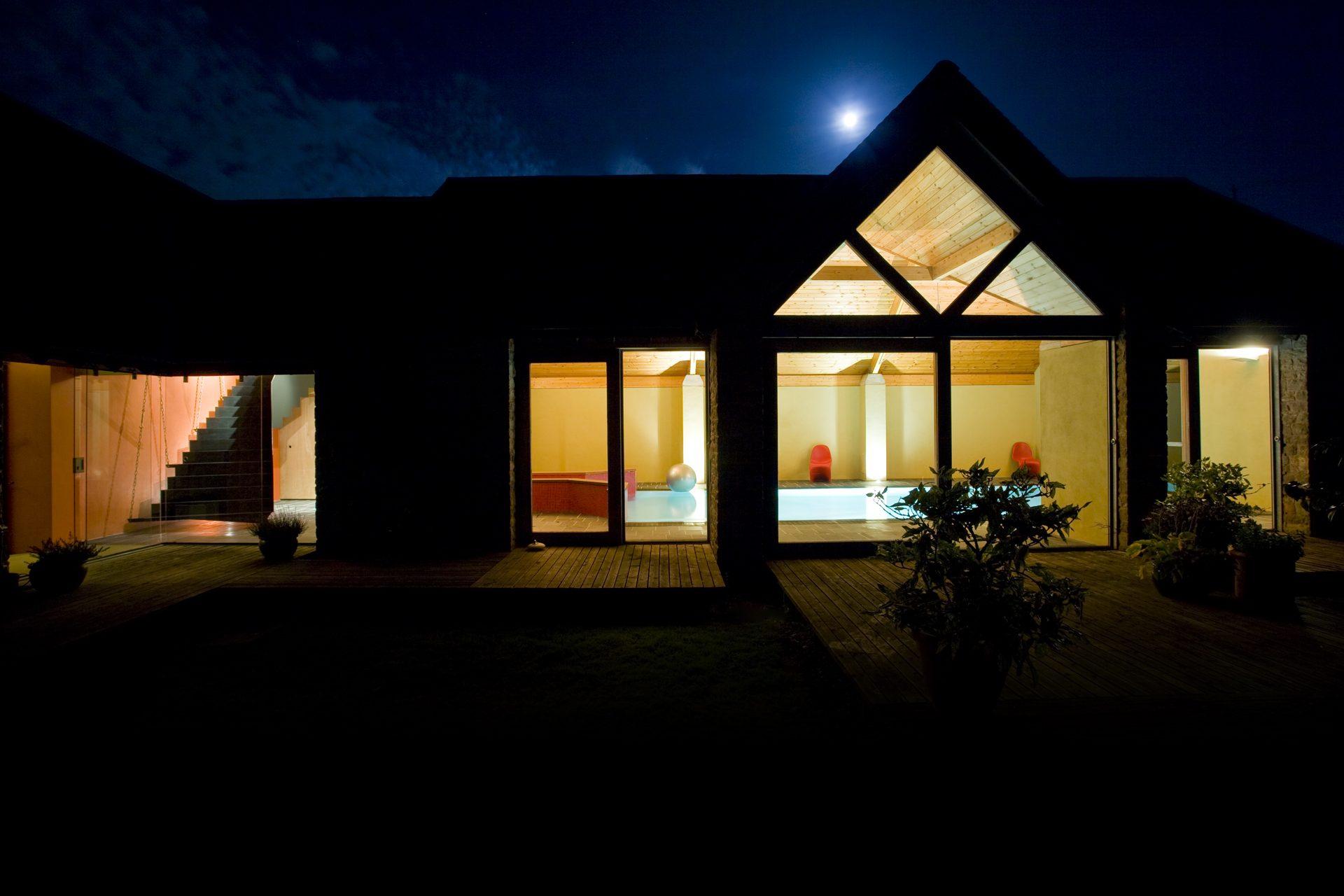 Ring house swimming pool garden at night
